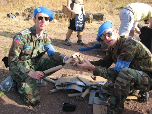 UNUCC Observers inspected cardboard tube debris during a 2008 skirmish