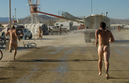 Water is distributed on the desert floor during Burning Man